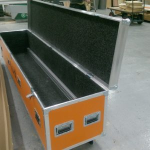 An orange laminated custom built flight case made from plywood with foam lining