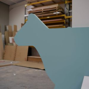 CNC MDF cut to shape of a cow and painted blue