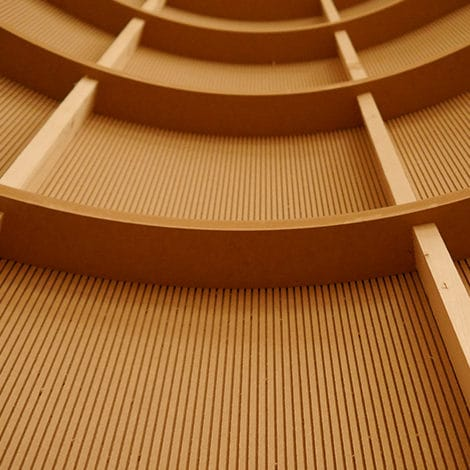 The rear view of a curved wall panel showing the CNC FR MDF curved frame clad with bendy MDF