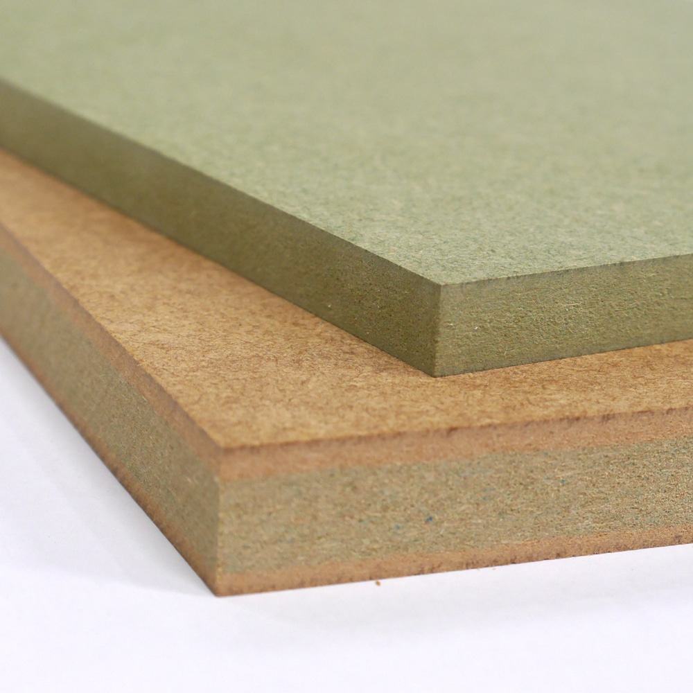 Two small pieces of Moisture Resistant MDF stacked on top of each other, one is 12mm MR MDF the other 18mm. Both show the green dye used to distinguish it from other MDF products