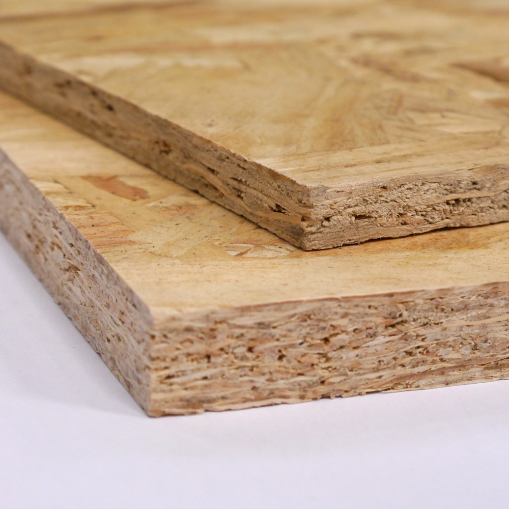A photo showing two pieces of OSB Board, one on top of the other, the bottom panel is 18mm thick OSB, the top panel is 11mm thick OSB.