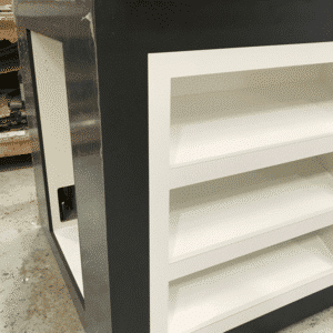 A black and white display product plinth finished in black laminate with a white laminate inlay