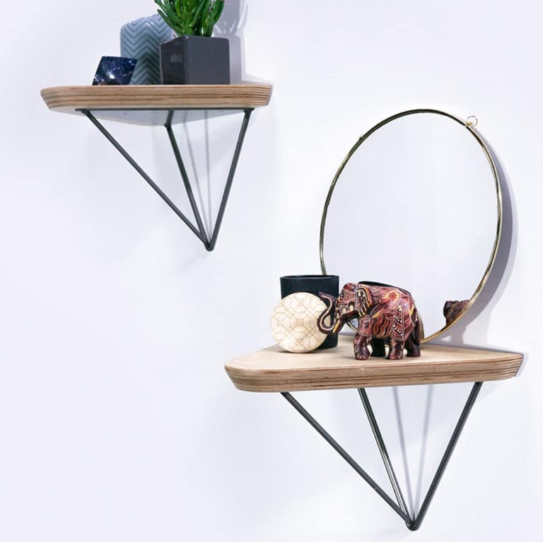 CNC machined triangular plywood shelves with 30 degree edge detail siting on Hairpin Leg Co Prism shelf brackets