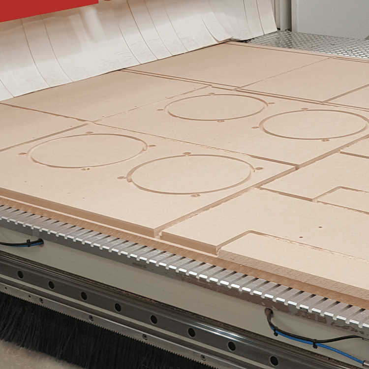 MDF on the CNC Machine Bed, cut to shape for bespoke speakers
