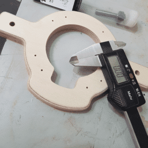 Birch Plywood component cut to shape with Vernier callipers and a router bit