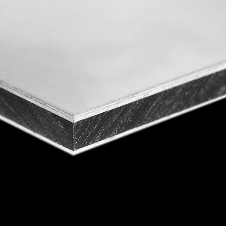 A piece of Dibond showing the detail of the material sandwiched between the aluminium