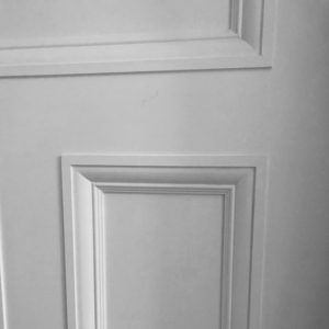 A close up photo showing a white painted reproduction Victoriandoor