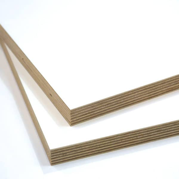 two pieces of white melamine faced birch plywood stacked on top of each other