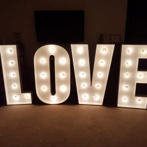Freestanding Hollywood style illuminated letters LOVE for wedding reception feature