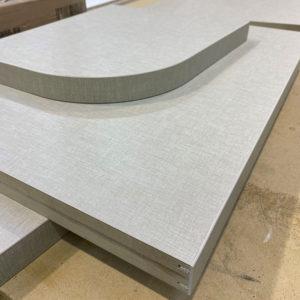 A 36mm Beige Linen MF MDF worktops on a workbench