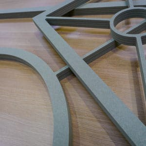 CNC routered moisture resistant frames for a bespoke glass cabinet doors