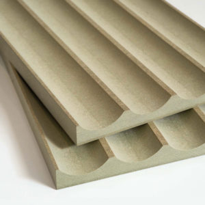 2 fluted pieces of moisture resistand MDF stacked on top of each other