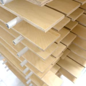 Clear Lacquered Birch Plywood Panels on a Drying Rack