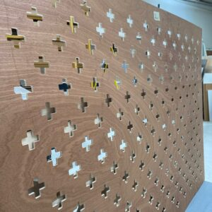 Perforated hardwood plywood mattress support panel