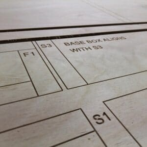 A Birch Plywood panel that has been cut and engraved on a CNC router